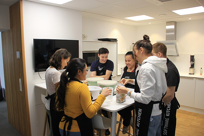 Some of the Compass Software trainees and working students banded together to bake some delicious cookies.
